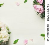 spring flowers layout. flat lay ... | Shutterstock . vector #1023333769