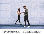 male and female hipsters... | Shutterstock . vector #1023333820
