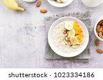 diet breakfast oats porridge... | Shutterstock . vector #1023334186