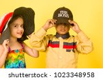 boy and girl children kids... | Shutterstock . vector #1023348958