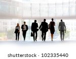 people walking against a light... | Shutterstock . vector #102335440