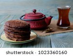 chocolate pancakes and tea on a ...   Shutterstock . vector #1023360160