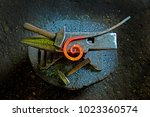 a hammer and a metal object of... | Shutterstock . vector #1023360574
