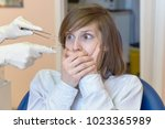 a young woman is shocked by the ... | Shutterstock . vector #1023365989