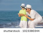 father and son playing on the... | Shutterstock . vector #1023380344