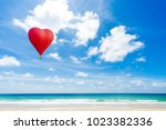 beautiful red balloon in the... | Shutterstock . vector #1023382336