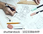 designer makes a sketch of the... | Shutterstock . vector #1023386449