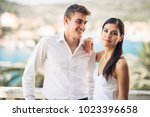 young couple visiting tropical... | Shutterstock . vector #1023396658