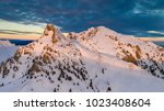 mountain top in winter. ciucas... | Shutterstock . vector #1023408604
