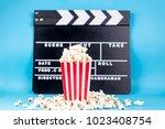 pop corn and clapper | Shutterstock . vector #1023408754