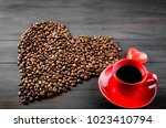 black coffee in red cup and... | Shutterstock . vector #1023410794