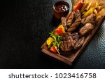 assorted delicious grilled meat ...   Shutterstock . vector #1023416758