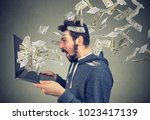 side view of man holding laptop ... | Shutterstock . vector #1023417139