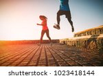 health fit young couple running ... | Shutterstock . vector #1023418144