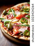 homemade flatbread pizza with... | Shutterstock . vector #1023424264