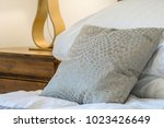 cushion on a bed in the bedroom | Shutterstock . vector #1023426649