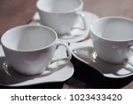 cups on plates | Shutterstock . vector #1023433420