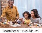 happy african american family... | Shutterstock . vector #1023434824