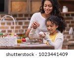 african american mother helping ... | Shutterstock . vector #1023441409