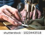 sewing process of the leather... | Shutterstock . vector #1023443518
