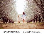 two little sisters dressed in... | Shutterstock . vector #1023448138