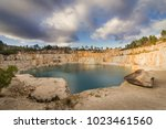 blue lake in mining industrial... | Shutterstock . vector #1023461560
