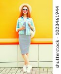fashion cool girl is using the... | Shutterstock . vector #1023461944