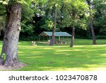 picnic area in a park | Shutterstock . vector #1023470878