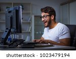 young man staying late in... | Shutterstock . vector #1023479194