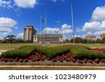 flowers in front of the jack k. ... | Shutterstock . vector #1023480979