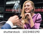woman drinking wine with her... | Shutterstock . vector #1023483190