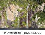 beautiful dramatic 2 waterfalls ...   Shutterstock . vector #1023483730
