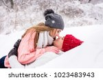 romantic girl and boy during... | Shutterstock . vector #1023483943