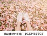 feet in white sneaker on the...   Shutterstock . vector #1023489808