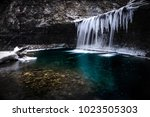 icy blue waterfall. columbus... | Shutterstock . vector #1023505303
