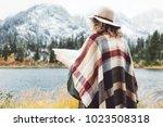 adventure woman reading map... | Shutterstock . vector #1023508318