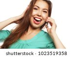 cheerful woman talking on the... | Shutterstock . vector #1023519358