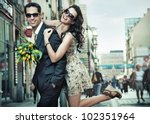 cheerful young couple on a city ... | Shutterstock . vector #102351964