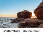 ocean coast at the sunrise ... | Shutterstock . vector #1023523060