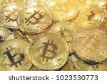 bitcoin cryptocurrency pile... | Shutterstock . vector #1023530773