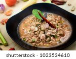 Small photo of Larb moo or pork salad is hot and spicy menu. Traditional dish and popular for thai people.
