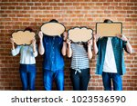 young adults holding up... | Shutterstock . vector #1023536590