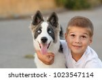 a little boy is hugging his...   Shutterstock . vector #1023547114