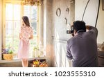 professional working of photographer take portrait fashion model at vintage interior studio in media production conceptual