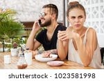 pretty female drinks hot... | Shutterstock . vector #1023581998