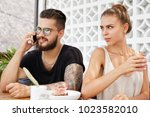 irritated angry jealous young... | Shutterstock . vector #1023582010