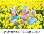 easter egg hunt in spring... | Shutterstock . vector #1023586414