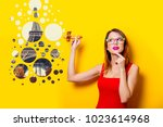young girl in red dress with... | Shutterstock . vector #1023614968