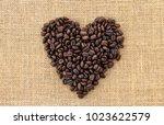 coffee beans in shape of heart... | Shutterstock . vector #1023622579
