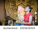 chinese woman wearing... | Shutterstock . vector #1023626524